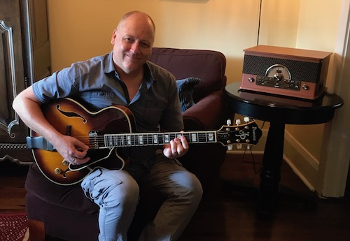 Image of a very classy looking Ibanez Joe Pass JP20 guitar being played by a very classy looking guitar teacher